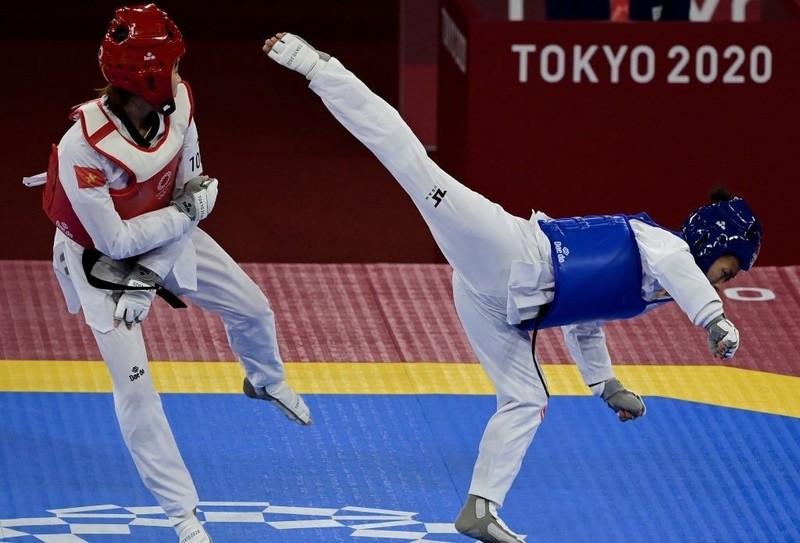Đánh bại võ sĩ Canada, Kim Tuyền vào tứ kết gặp Thái Lan - ảnh 1