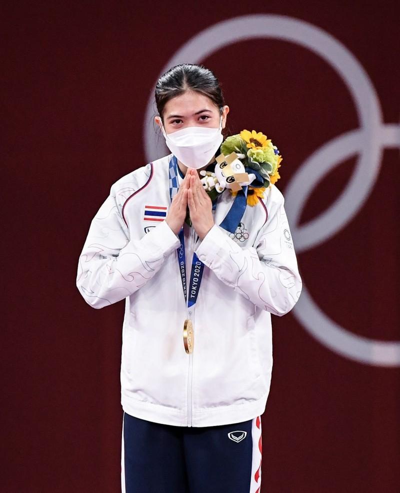Những HCV ngày thi đấu Olympic qua hình ảnh - ảnh 10