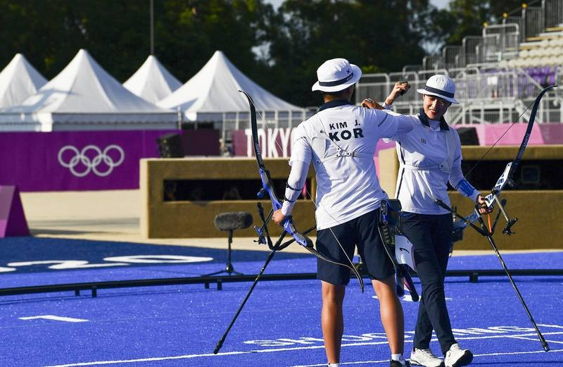 Những HCV ngày thi đấu Olympic qua hình ảnh - ảnh 4