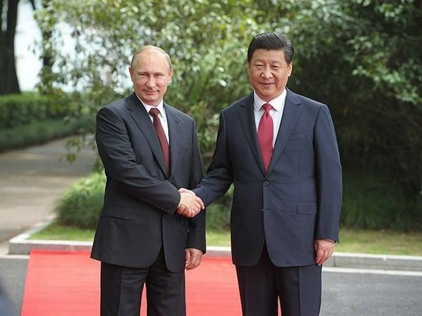 Nga-Trung cam kết hỗ trợ nhau bảo đảm chủ quyền, toàn vẹn lãnh thổ - ảnh 1