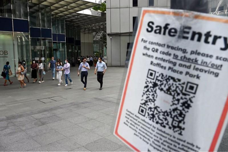 Dịch tái bùng mạnh và chiến lược đối phó bình tĩnh của Singapore - ảnh 1