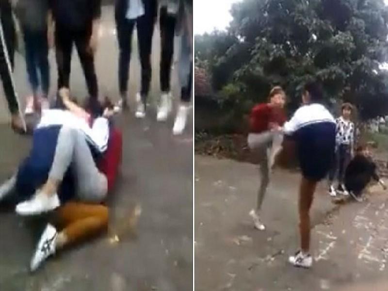 Hai nữ sinh lao vào đánh nhau, bạn đứng xem rồi cá cược - ảnh 1
