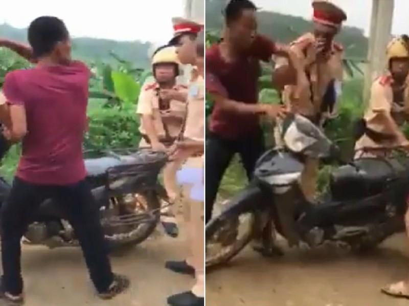 CSGT lên tiếng vụ 'dắt xe máy cũng bị xử phạt' - ảnh 1