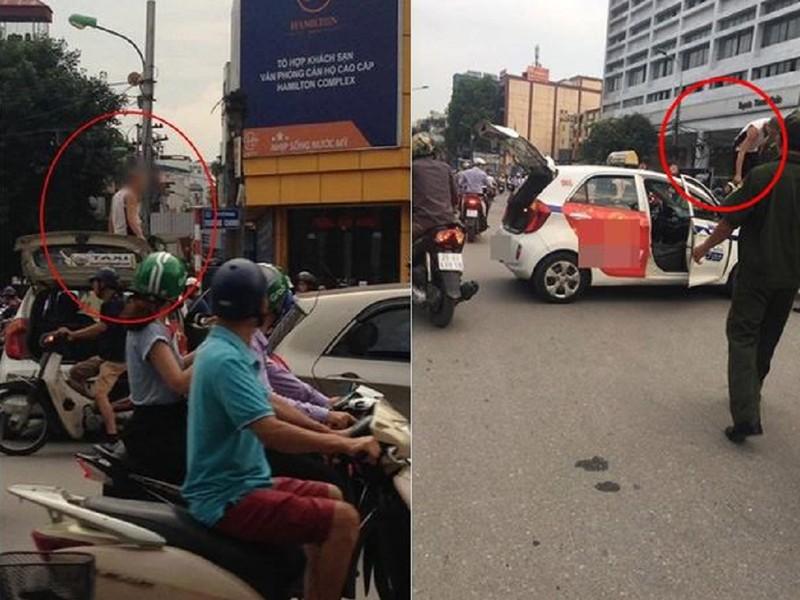 Bị dừng xe, tài xế taxi leo lên nóc 'ăn vạ' - ảnh 1