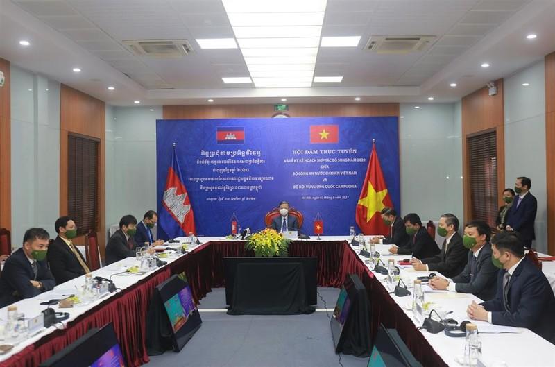 Bộ Công an Việt Nam và Bộ Nội vụ Campuchia phối hợp phòng, chống COVID-19 - ảnh 1