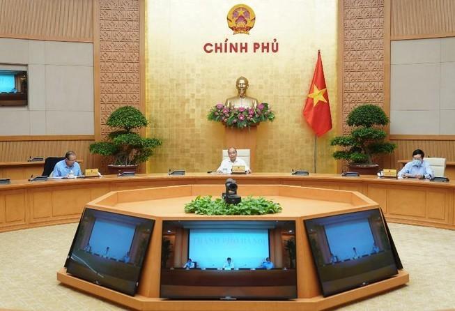 Thủ tướng: Phát triển kinh tế song song với giãn cách xã hội - ảnh 2