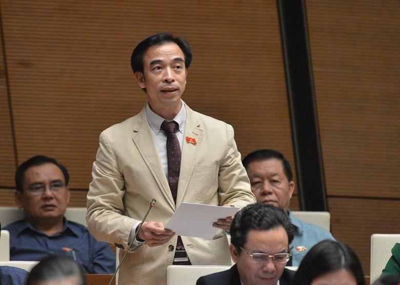 Ra nghị quyết rút tên ông Nguyễn Quang Tuấn - ảnh 1