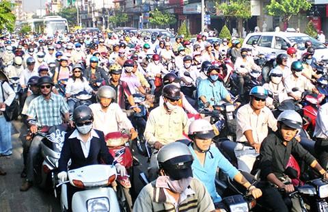 Phí đường bộ với xe máy: Vẫn loay hoay - ảnh 1