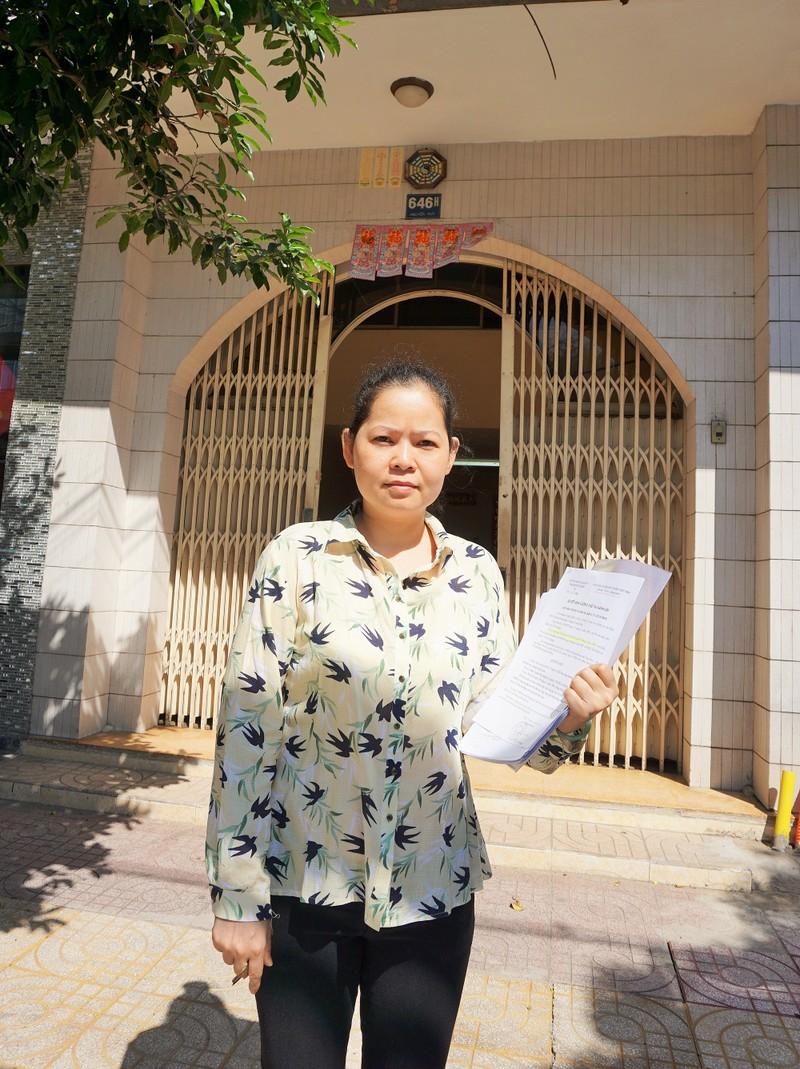 Bà Nguyễn Ngọc Kiều Trang cho rằng Cục THA TP.HCM chưa rõ nghĩa vụ bà phải trả nợ mà đòi bán nhà của bà là trái với pháp luật. Ảnh: N.NGA