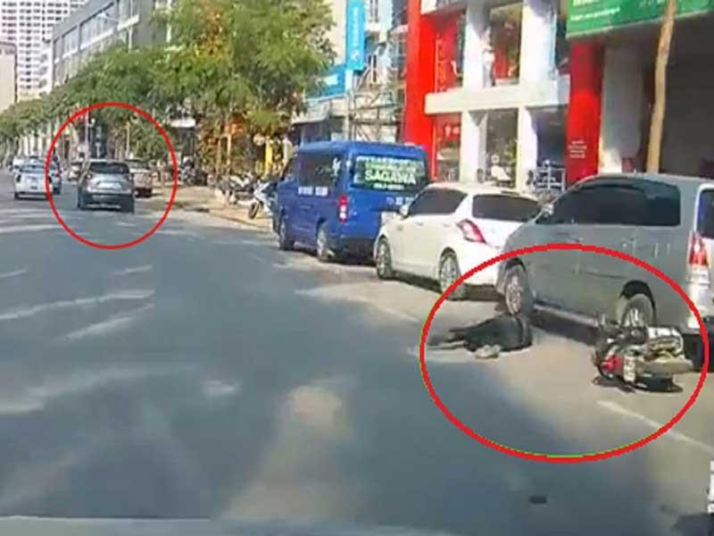 Nghi ô tô cố tình tông xe máy trên đường - ảnh 1