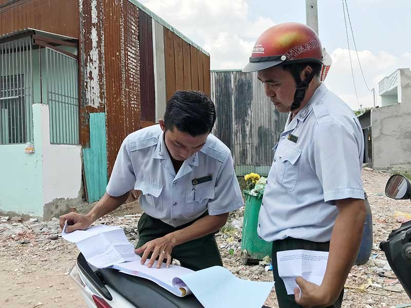 Tiếp tay vi phạm xây dựng có thể bị xử hình sự - ảnh 1