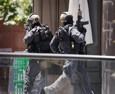 Khủng bố Hồi giáo bắt cóc 40 con tin tại Sydney - ảnh 5