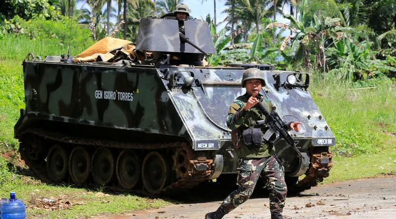 2.000 dân kẹt lại Marawi, chân rết IS dọa tử hình - ảnh 4
