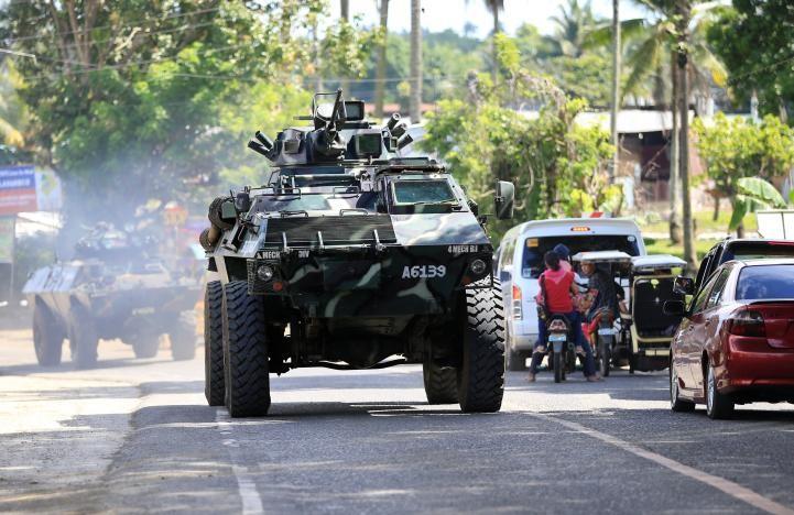 Philippines cảnh cáo khủng bố: Đầu hàng hay là chết! - ảnh 1
