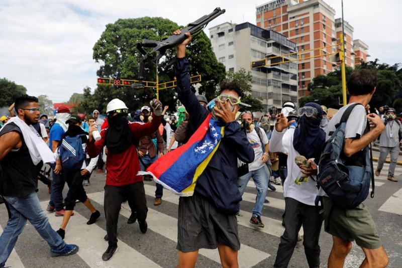Venezuela ngày bầu cử: Bạo lực leo thang nghiêm trọng - ảnh 1