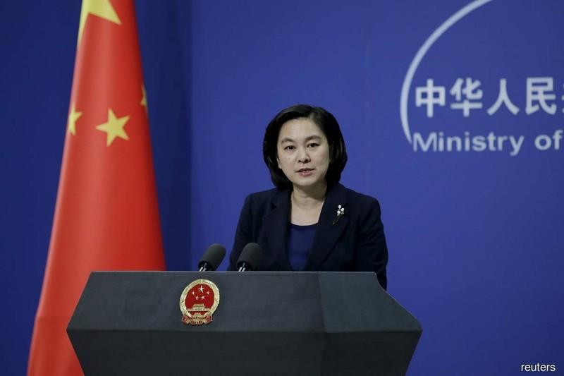 Trung Quốc nói sẽ 'phản ứng chính đáng' các hạn chế mới của Mỹ - ảnh 1