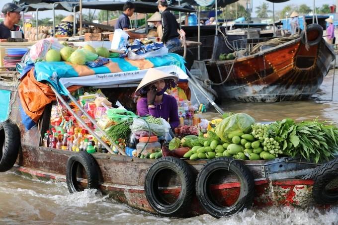 Chợ nổi Cái Răng qua ống kính du khách nước ngoài - ảnh 4