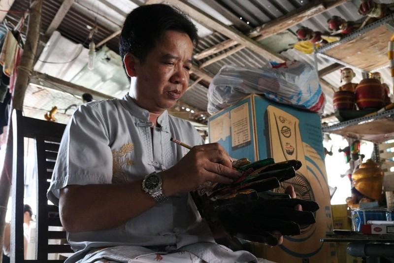 Nghệ nhân với những con rối nước hiếm hoi ở Sài Gòn - ảnh 1