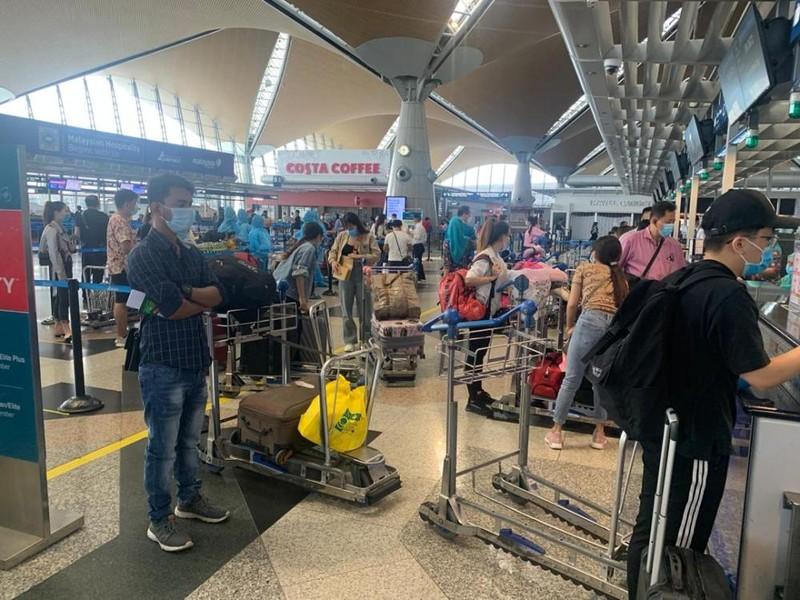 310 công dân Việt Nam từ Malaysia về nước an toàn - ảnh 1