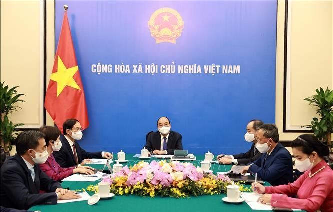 Chủ tịch nước Nguyễn Xuân Phúc điện đàm với Tổng thống Pháp - ảnh 1