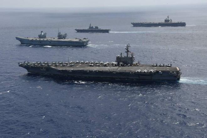 Việt Nam lên tiếng việc tàu chiến Anh và New Zealand cùng tiến vào Biển Đông - ảnh 1