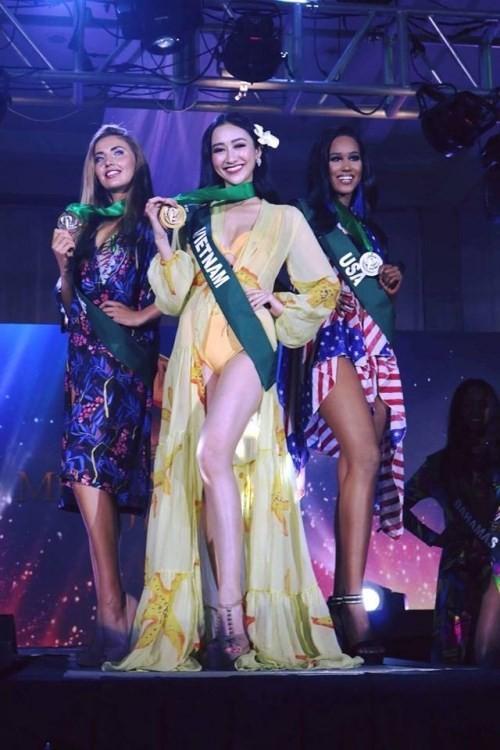 Hà Thu 'ẵm' giải đồng Trang phục dạ hội tại HH Trái đất - ảnh 4
