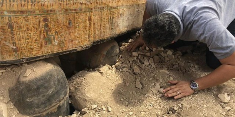 Egyptian Minister of Antiquities Khaled el-Anany looking at recently discovered coffins in Luxor.