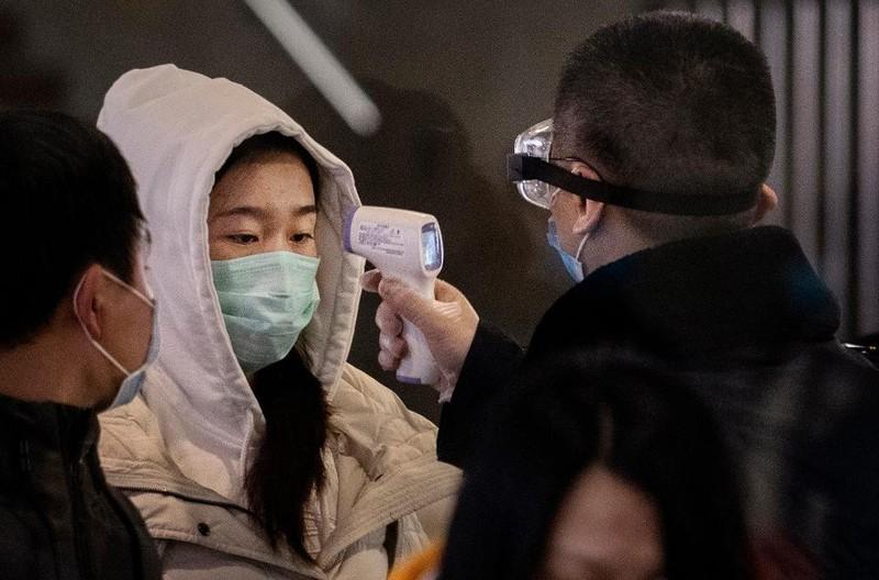 26 người chết, 8 thành phố bị 'cấm cửa' do virus corona mới - ảnh 2