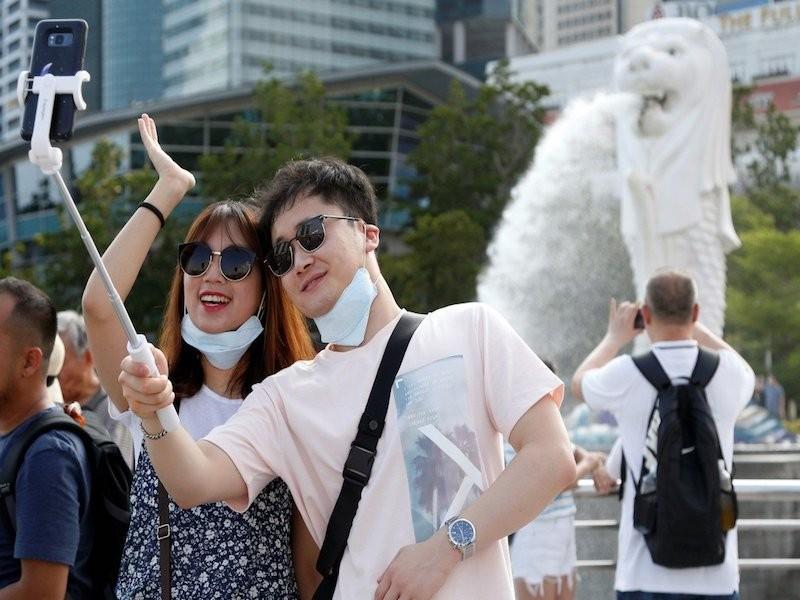 Đến lượt Singapore, Nhật Bản bị vạ lây vì dịch Corona - ảnh 2