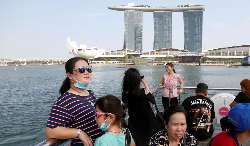 Đến lượt Singapore, Nhật Bản bị vạ lây vì dịch Corona - ảnh 1