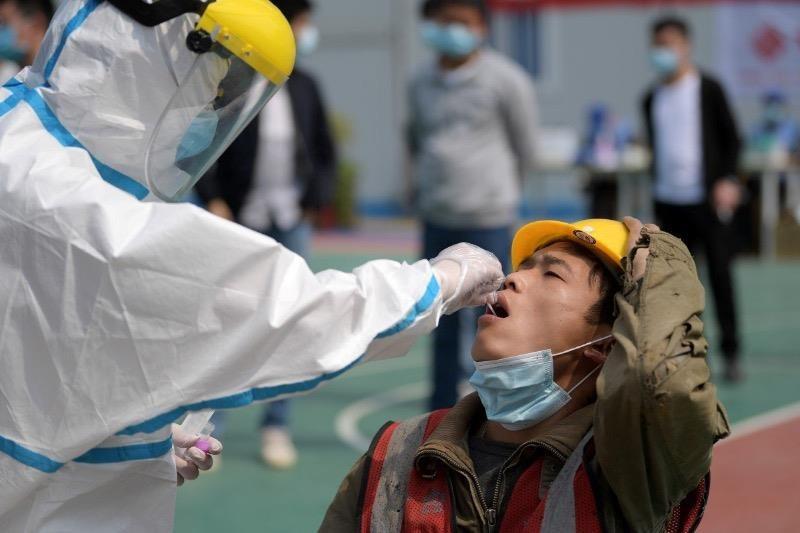 Trung Quốc quyết rà soát số nhiễm COVID-19 không triệu chứng  - ảnh 1