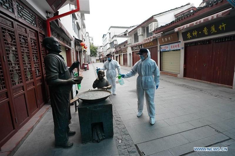 Nhiễm mới tại Trung Quốc tăng vọt đến gần 100 người - ảnh 3