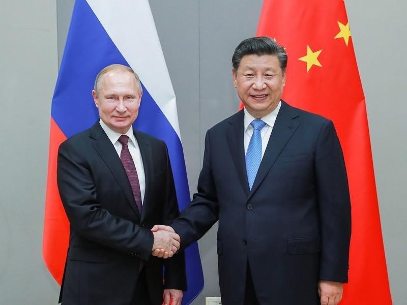 Hai ông Putin-Tập: Nỗ lực bôi nhọ Trung Quốc sẽ phản tác dụng - ảnh 1