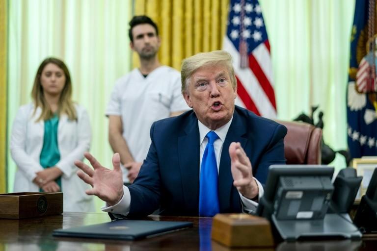 Ông Trump nói COVID-19 tệ hơn Trân Châu Cảng, khủng bố 11-9 - ảnh 1