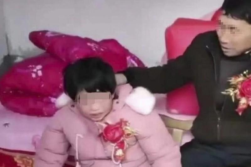 Dư luận Trung Quốc bức xúc vì 'đám cưới' của cô gái thiểu năng - ảnh 1