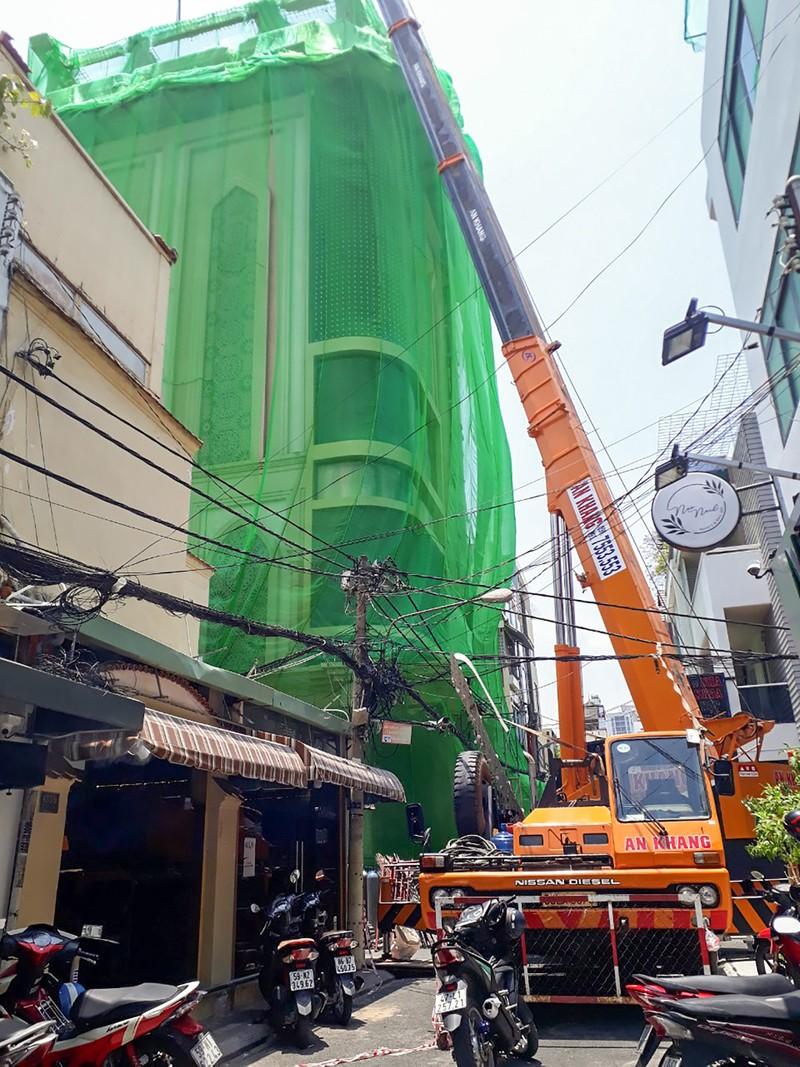 Cận cảnh cưỡng chế công trình xây dựng vượt tầng quận 10 - ảnh 3