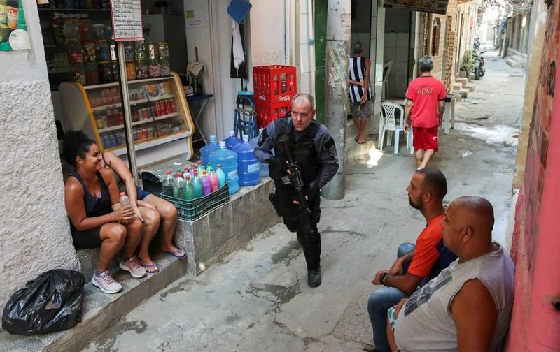 Brazil: Cảnh sát đấu súng với tội phạm ma túy, 25 người chết - ảnh 4