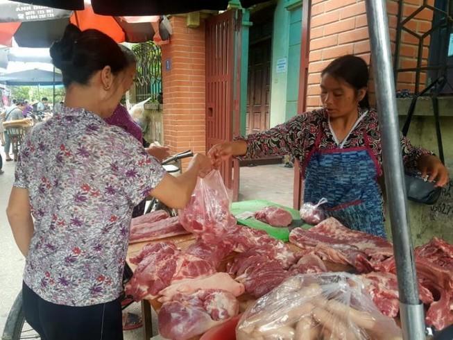 Dịch Corona khiến doanh nghiệp khó ra nước ngoài tìm thịt heo  - ảnh 1