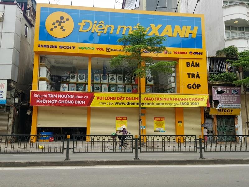 Hàng loạt cửa hàng tại Hà Nội đóng cửa chống dịch COVID-19 - ảnh 5