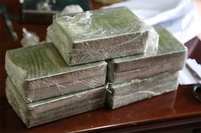 Lợi dụng mưa lũ buôn heroin - ảnh 2