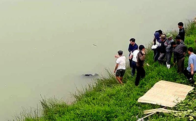 Thi thể nam thanh niên trôi trên sông Chu - ảnh 1