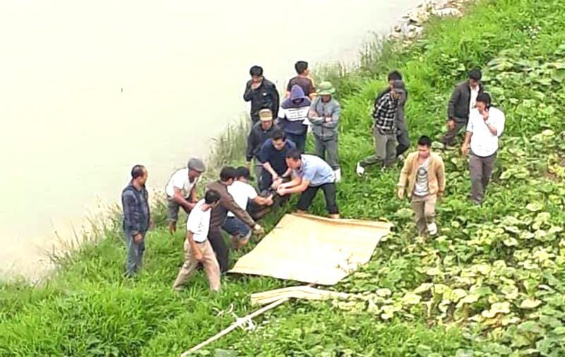 Thi thể nam thanh niên trôi trên sông Chu - ảnh 2