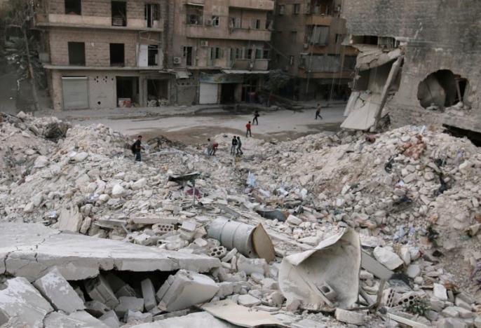 Quang cảnh tan hoang vì không kích ở TP Aleppo nơi phe nổi dậy kiểm soát ngày 29-9.