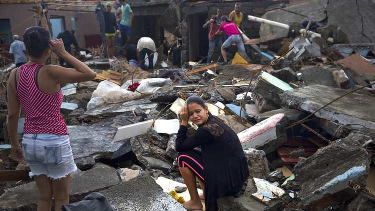 Nhà cửa sập đổ ở Haiti vì bão Matthew ngày 5-10.