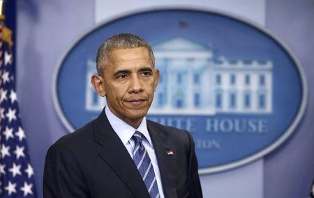 Tổng thống Obama họp báo tại Nhà trắng ngày 16-12. Ảnh: REUTERS