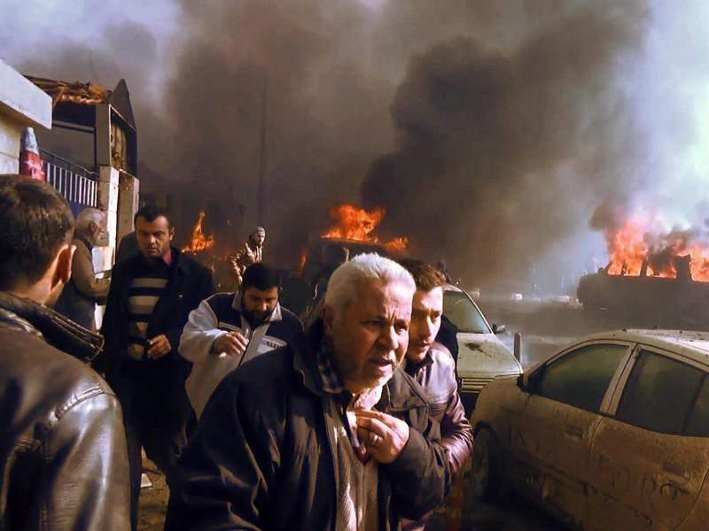 Hàng chục người chết trong vụ đánh bom xe tải này. Ảnh: AFP