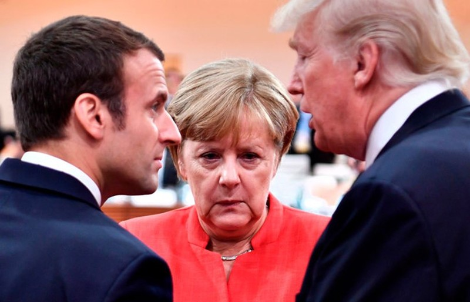 Tổng thống Mỹ Donald Trump (phải) đã điện đàm với Thủ tướng Đức Angelar Merkel (giữa) và Tổng thống Pháp Emmanuel Macron (trái) về tuyên bố hạt nhân cứng rắn của Tổng thống Nga Vladimir Putin. Ảnh: GETTY IMAGES