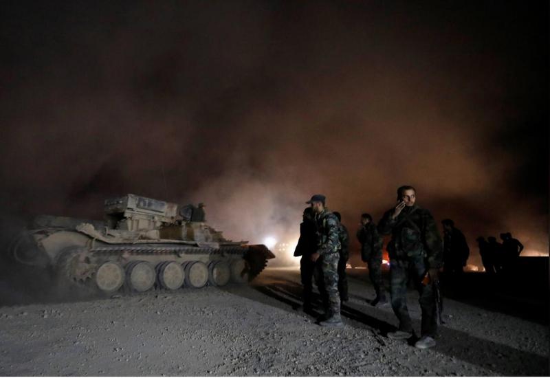 Binh sĩ Syria tại thị trấn Harasta, Đông Ghouta ngày 22-3. Ảnh: REUTERS