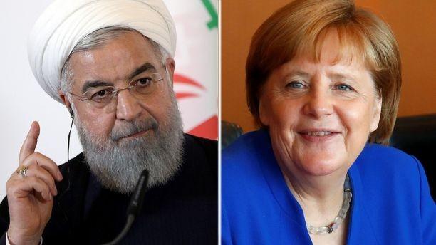 Vì áp lực từ Mỹ, chính phủ Thủ tướng Đức Angela Merkel (phải) ra tay phong tỏa khoản 400 triệu đô Mỹ chuyển về cho chính phủ Tổng thống Iran Hassan Rouhani (trái). Ảnh: REUTERS