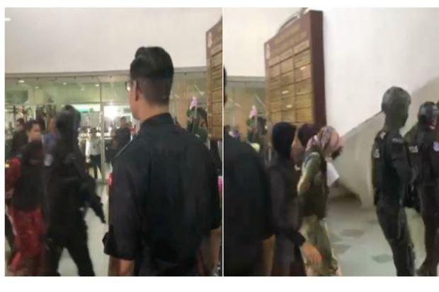 Hai bị cáo Siti Aisyah (trái) và Đoàn Thị Hương (phải) được hộ tống đến tòa sáng nay 16-8. Ảnh: THE STAR